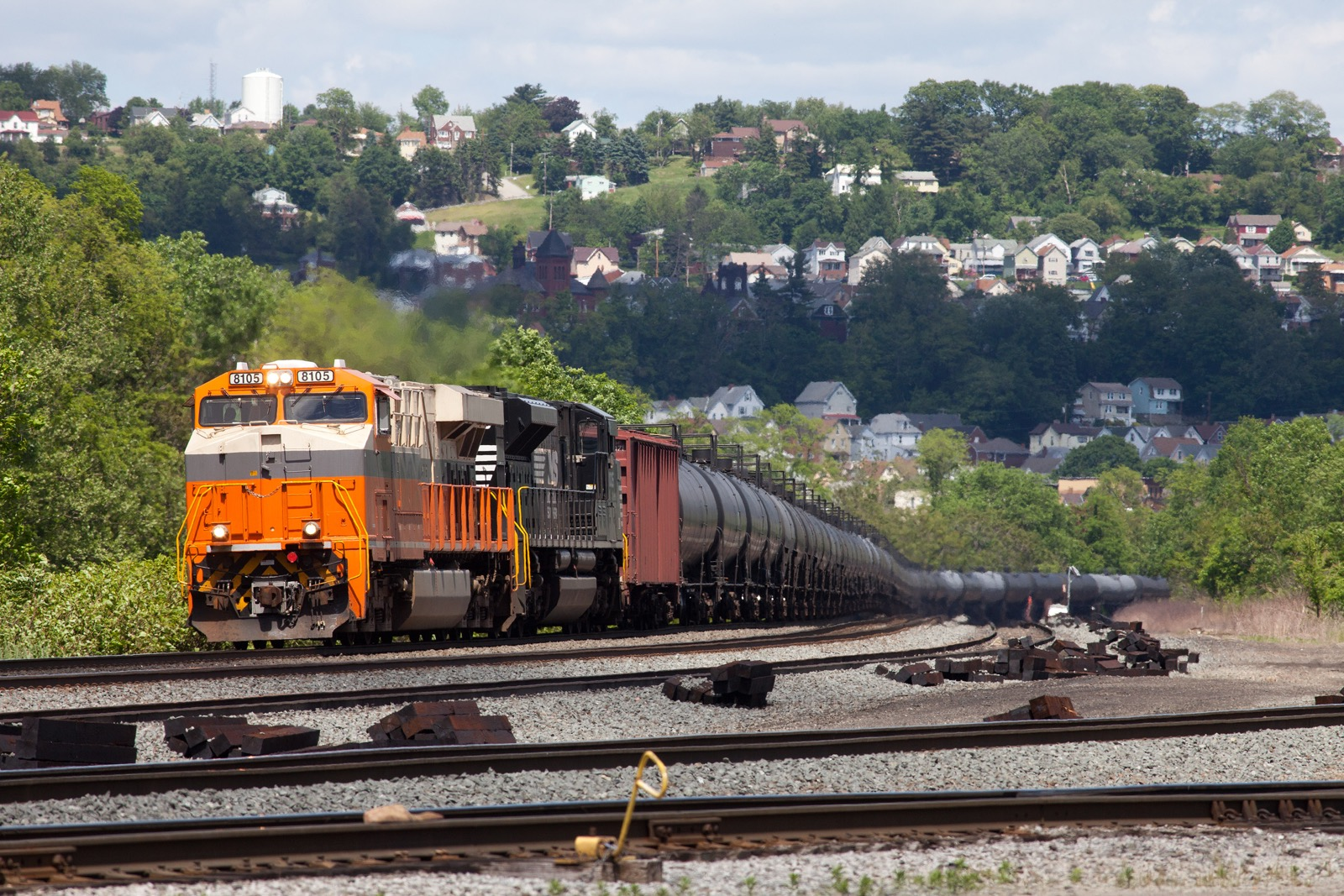 NS 8105 Interstate Heritage unit ES44AC leading westbound oil train 65R at Pitcairn Yard