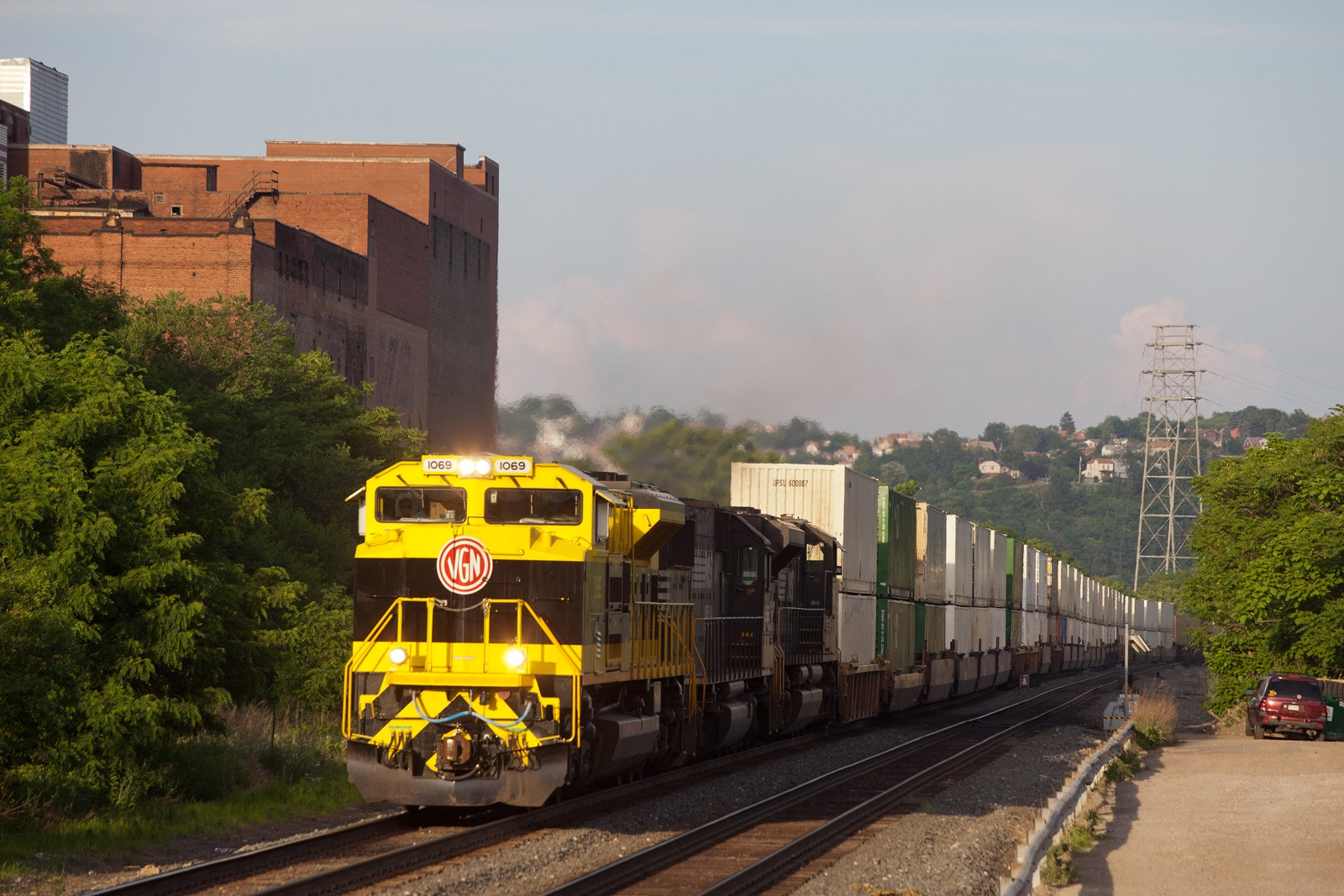 NS 1069 Virginian Heritage unit leads NS 21M doublestack train west on the Mon Line.