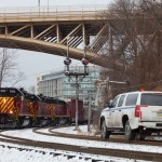 AVR 3003 SD40-3 leads the AVR Bakerstown turn (running as CSXT Z401-06) past the ancient B&O color position light signals at East Schenley, while a CSXT Trainmaster looks on from his Chevy Hy-rail truck.  January 6, 2014