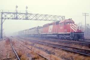 "CNJ 3067 ""Red Baron"" leading ES-98 at Spring St, Elizabeth NJ Feb '76. Peter McGilligan photo"