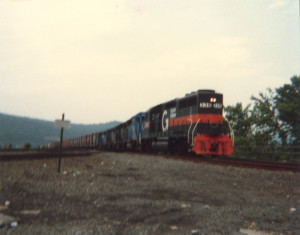 "My first train photo. The ""D&H Train"" at Rockville Bridge, Harrisburg, Penn. June, 1987. Boston & Maine 338 wears the grey-and-orange colors of Guilford Rail Transportation, who acquired B&M, MEC, and D&H in the early 1980. The four blue locomotives behind are Boston & Maine GP38's in their as-delivered blue."