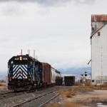 MRL 844 Local with a pair of GP35s, MRL 406-MRL 403, screeches into Willow Creek to set off a ballast hopper.